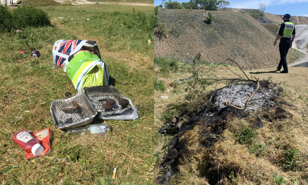 discarded disposable bbq, ketchup bottle and plastic bags. Also police officer walking next to small extinguished grass fire