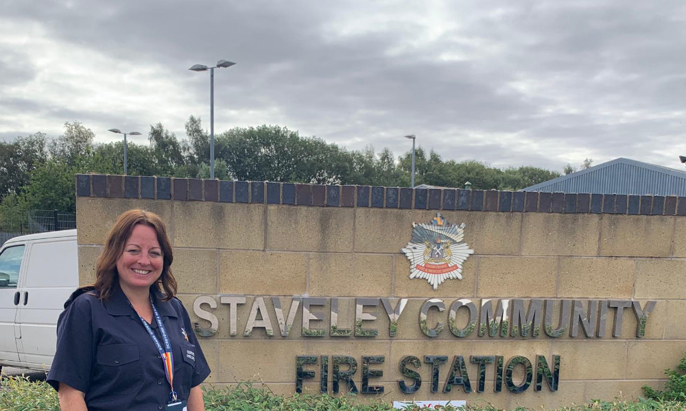 sarah posing outside staveley community fire station