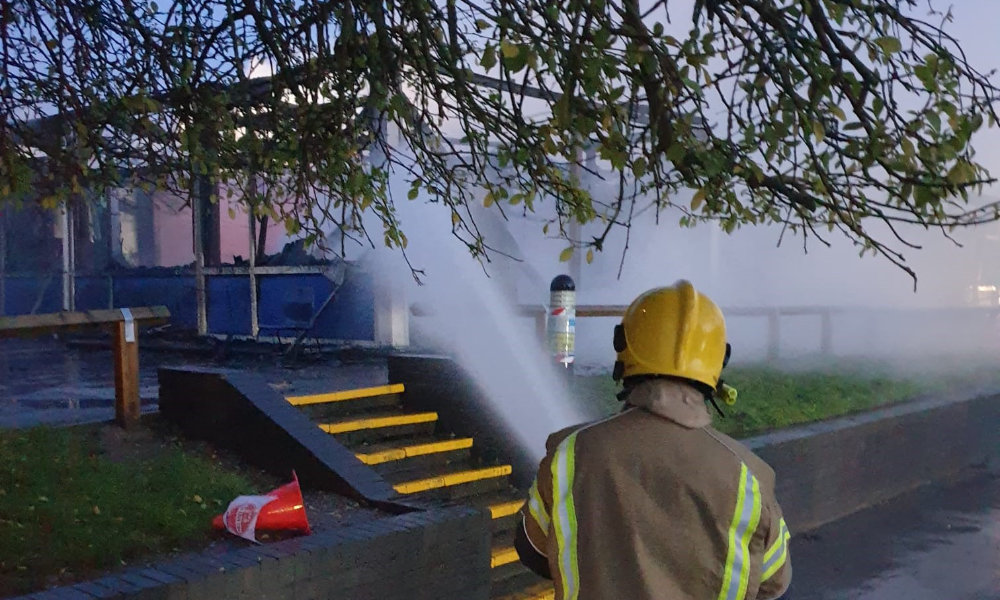 lone firefighter hosing down classrooms