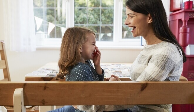 mother and child in family room laughing together