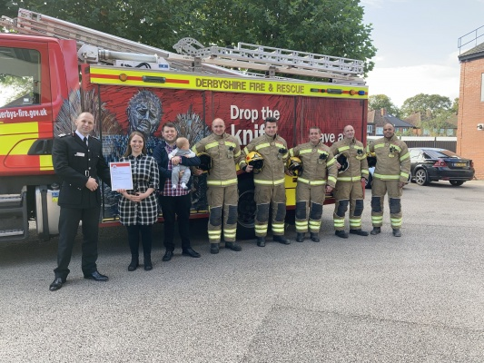 crew and award recipients stood in front of fire engine