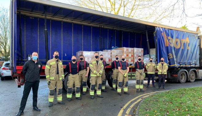 Firefighters in Gold Kit stood in front of open sided lorry containing testing equipment